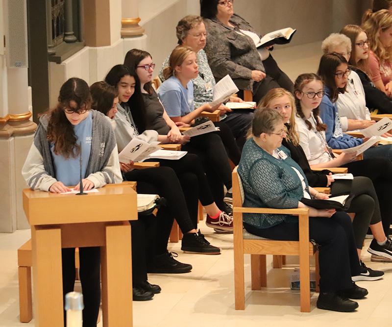 Regina Dominican HS members at morning prayer with Sisters