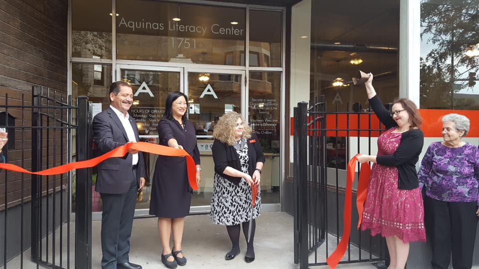 Image of ribbon-cutting ceremony at Aquinas Literacy Center for new location