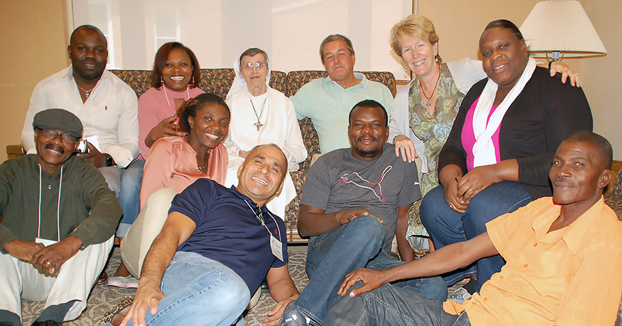 Former residents of Haitian orphanage visit with Sister Philomena Perreault at the Adrian Motherhouse