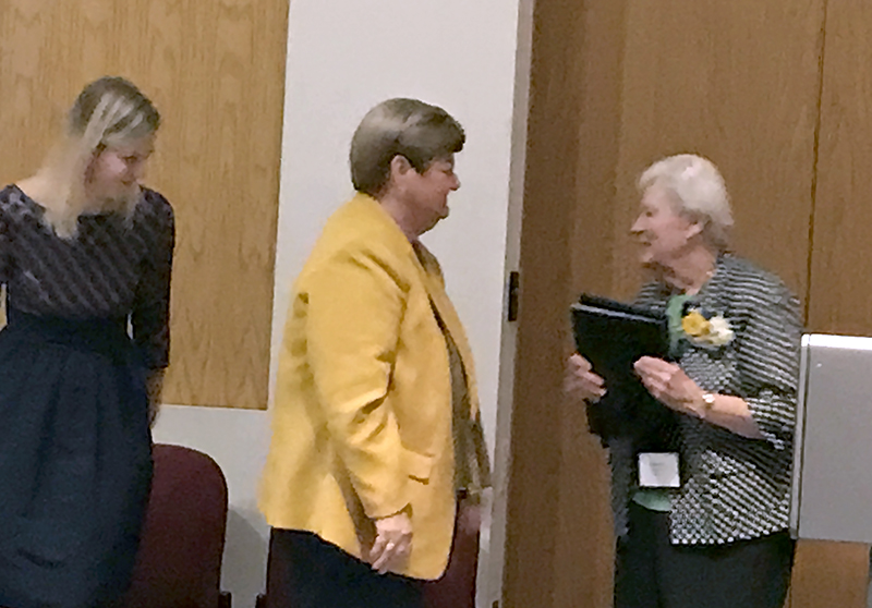 Sister Patricia Dulka, OP, right, receives the St. Dominic Award from Sister Peg Albert, OP, President of Siena Heights University, center. Also pictured is Katie Hatch '07, President of the Alumni Association.