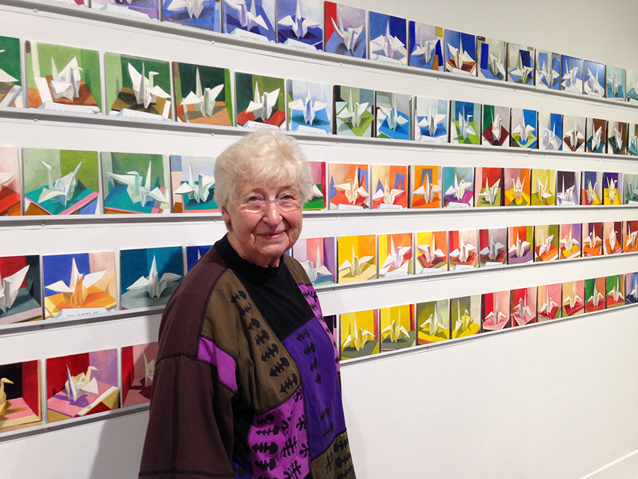 Sister Barbara Cervenka, OP, with some of the 1,000 cranes she painted