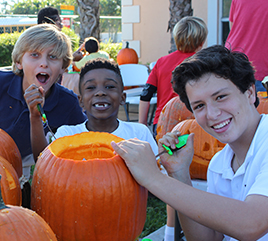 Rosarian Students Offer Pumpkin Carving Event for Less Fortunate Students